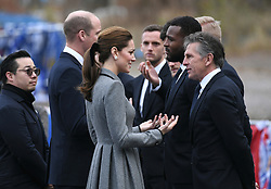 The Duke and Duchess of Cambridge speak to Leicester City manager Claude Puel (right), Wes Morgan and Andy King during their visit to The King Power Stadium to pay tribute to those who lost their lives in the Leicester City helicopter crash including Leicester City Chairman Vichai Srivaddhanaprabha