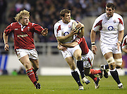 Mark Cueto running with the ball supported by Simon Shaw and tackled by Gareth Cooper running in Duncan Jones,2006 RBS Six Nations Match, England vs Wales, Twickenham on the 04.02.2006.   © Peter Spurrier/Intersport Images - email images@intersport-images mob +44[0]7973 819 551..   [Mandatory Credit, Peter Spurier/ Intersport Images].