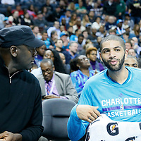 03 November 2015: Michael Jordan is seen talking to Charlotte Hornets forward Nicolas Batum (5) during the Charlotte Hornets  130-105 victory over the Chicago Bulls, at the Time Warner Cable Arena, in Charlotte, North Carolina, USA.