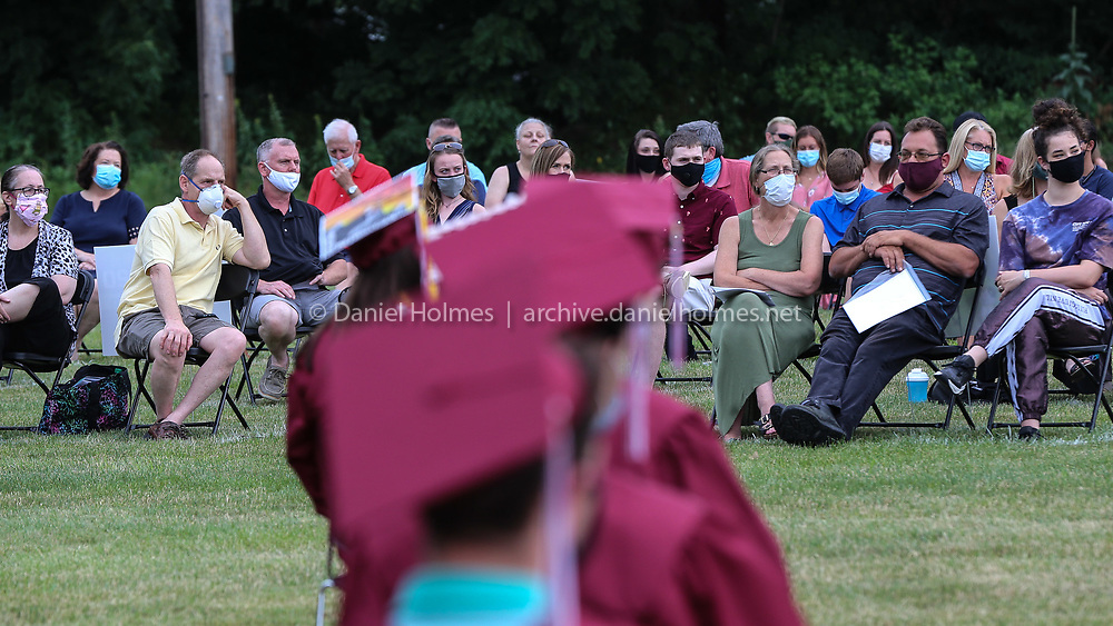 (7/30/20, MILLIS, MA) Masked family members listen  during the graduation ceremony at Millis High School on Thursday. [Daily News and Wicked Local Photo/Dan Holmes]