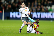 Cheikhou Kouyate of West Ham United fouls Henrikh Mkhitaryan of Manchester United. Premier league match, West Ham Utd v Manchester Utd at the London Stadium, Queen Elizabeth Olympic Park in London on Monday 2nd January 2017.<br /> pic by John Patrick Fletcher, Andrew Orchard sports photography.