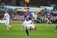 Andre Ayew of Swansea city has an overhead shot at goal under pressure from Joel Ward of Crystal Palace. Barclays Premier league match, Swansea city v Crystal Palace at the Liberty Stadium in Swansea, South Wales on Saturday 6th February 2016.<br /> pic by Andrew Orchard, Andrew Orchard sports photography.