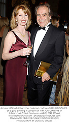 Actress JANE ASHER and her husband cartoonist GERALD SCARFE, at a gala evening in London on 17th June 2002.PBB 57