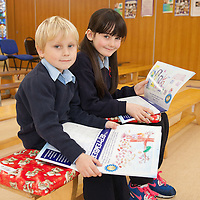 Peter Cizio and Cleo Mahony showing their winning Artwork in the Clare Care Springboard Calendar