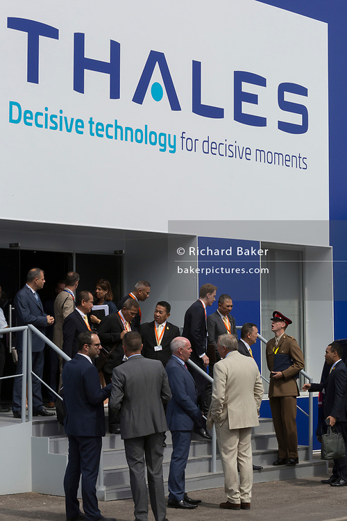 Accompanied by British military personnel, potential customers leave the Thales exhibition and hospitality chalet at the Farnborough Airshow, on 16th July 2018, in Farnborough, England. (Photo by Richard Baker / In Pictures via Getty Images)