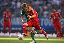 Football: Germany, Liga Total Cup, FC Bayern Muenchen - SV Werder Bremen, Hamburg, 04.08.2012.Clemens Fritz (Werder, l.) - Xherdan Shaqiri (Bayern).©Êpixathlon