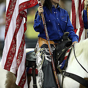 A flag bearer  during the 129th performance of the PRCA Silver Spurs Rodeo at the Silver Spurs Arena   on Friday, June 1, 2012 in Kissimmee, Florida. (AP Photo/Alex Menendez) Silver Spurs rodeo action in Kissimee, Florida. PRCA rodeo event in Florida. The 129th annual running of the cowboy event.