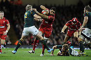 Toby Faletau of Wales is stopped by South Africa's Jean De Villiers. Autumn International rugby, 2013 Dove men series, Wales v South Africa at the Millennium Stadium in Cardiff,  South Wales on Saturday 9th November 2013. pic by Andrew Orchard, Andrew Orchard sports photography,