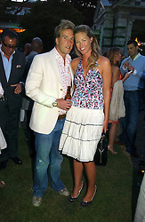 BEN FOGLE and MARINA HUNT at the Quintessentially Summer Party held at Debenham House, 8 Addison Road, London W14 on 15th June 2006.<br /><br />NON EXCLUSIVE - WORLD RIGHTS