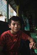 Loklahung, Indonesia - February 28, 2017: Rindi, age 13, at a warung in Loklahung, South Kalimantan, located on the island of Borneo