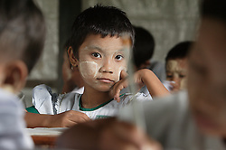 Shwe Yee Phuu (7)  in Grade 1 class. UNICEF has supported this and many other schools with study materials and teaching kits, in Laputtaloke Taung village close to Lamputta, Myanmar.
