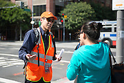 Jason, an SFMTA representative, helps a customer figure out which bus to take to the East Bay. A Bart strike caused chaos for commuters coming in and out of San Francisco. AC Transit and San Francisco Bay Ferry managed the trans bay commutes, while Muni handled the dissplaced commuters within San Francisco.   July 2, 2013