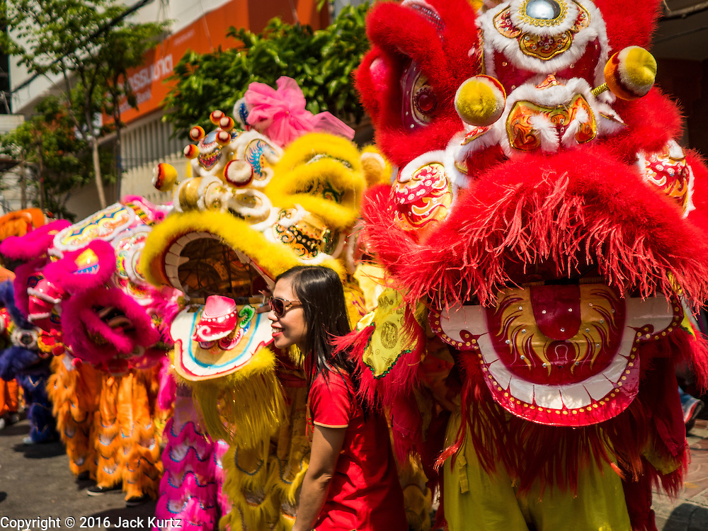 """08 FEBRUARY 2016 - BANGKOK, THAILAND:  Lion dancers wait to perform in Bangkok's Chinatown district during the celebration of the Lunar New Year. Chinese New Year is also called Lunar New Year or Tet (in Vietnamese communities). This year is the """"Year of the Monkey."""" Thailand has the largest overseas Chinese population in the world; about 14 percent of Thais are of Chinese ancestry and some Chinese holidays, especially Chinese New Year, are widely celebrated in Thailand.      PHOTO BY JACK KURTZ"""