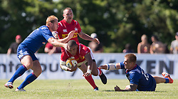 June 16, 2018 - Ottawa, ON, U.S. - OTTAWA, ON - JUNE 16: Doug Fraser (13 Centre ) of Canada dives through two Russian players in the Canada versus Russia international Rugby Union action on June 16, 2018, at Twin Elms Rugby Park in Ottawa, Canada. Russia won the game 43-20. (Photo by Sean Burges/Icon Sportswire) (Credit Image: © Sean Burges/Icon SMI via ZUMA Press)