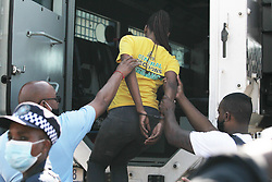 South Africa - Durban - 20 July 2020 - Police try to disperse an angry crowd in Lamontville, South of of Durban after they went on a rampage, burning municipal cars, blocking the roads with burning tyres and rubble, demanding their electricity be reinstated<br /> Picture: Doctor Ngcobo/African News Agency(ANA)