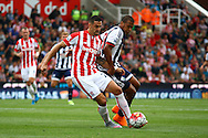Geoff Cameron of Stoke City and Jose Salomon Rondon of West Bromwich Albion battle for the ball. Barclays Premier League match, Stoke city v West Bromwich Albion at the Britannia stadium in Stoke on Trent, Staffs on Saturday 29th August 2015.<br /> pic by Chris Stading, Andrew Orchard sports photography.