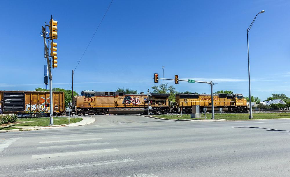 Union Pacific Freight train passing through downtown Hondo, Texas, USA
