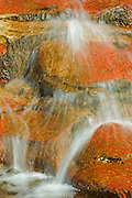 Detail of water flowing over rocks in Red Rock Canyon<br /> Waterton Lakes National Park<br /> Alberta<br /> Canada<br /> Waterton Lakes National Park<br /> Alberta<br /> Canada