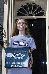 Four young campaigners, Anna, Beth, Nikita and Abigail deliver a petition with 22,000 signatures to no 10 Downing Street calling on government to increase its funding for Childline, which is struggling to cope with demand, with counsellors only able to respond to three in every four children who need help. London, May 09 2018.