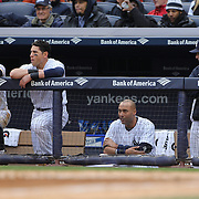 Watching from the New York Yankees dugout, from left,  Brett Gardner, Jacoby Ellsbury, Derek Jeter and Joe Girardi during the New York Yankees V Baltimore Orioles home opening day at Yankee Stadium, The Bronx, New York. 7th April 2014. Photo Tim Clayton
