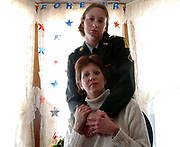 Sub2/12/03  Photo by Mara Lavitt-Scott&Fouts 3<br /> ML0053A #9272<br /> Pfc. Kristina Scott Fouts top and her mom Spc. Brenda Scott at home in Cheshire just days before Kristina's deployment.