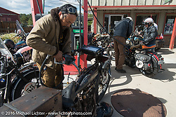 Shinya Kimura at a gas stop at the Pine Junction, CO Country Store with his Team 80 1915 Indian Twin during Stage 9 (249 miles) of the Motorcycle Cannonball Cross-Country Endurance Run, which on this day ran from Burlington to Golden, CO., USA. Sunday, September 14, 2014.  Photography ©2014 Michael Lichter.