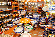 Display of tiles and pottery inside Santa Ana ceramic tile shop in Triana, Seville, Spain