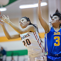Wingate Bear Ricondra Yazzie (3) and Zuni Thunderbird Alexis Leekela (3) compete for a rebound Thursday at WIngate High School.