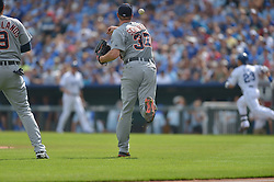 Sep 20, 2014; Kansas City, MO, USA; Detroit Tigers starting pitcher Max Scherzer (37) fields a ground ball and throws to first base in the first inning against the Kansas City Royals at Kauffman Stadium. Mandatory Credit: Denny Medley-USA TODAY Sports