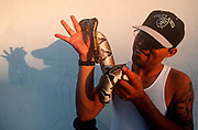 A young man holds his pet python in Miami Beach, on 15th May 1996, in Miami, Florida USA.