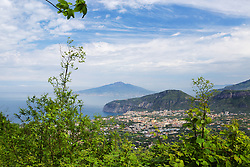 Sorrento Italy, the west end of the Amalfi Coast. Stretching about 30 miles or 50km along the southern side of the Sorrentine Peninsula, most famous for the town of Sorrento, the Amalfi Coast (Costiera Amalfitana) is one of Europe's most breathtaking. Cliffs terraced with scented lemon groves sheer down into sparkling seas; whitewashed and pastel colored villas cling precariously to unforgiving slopes while sea and sky merge in one vast blue horizon.