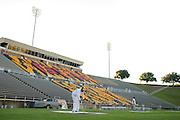 Louis Wright and Terry Lee begin painting the field at Eddie Robinson Stadium in advance of Grambling State Universities game against Texas Southern on October 26th in Grambling, Louisiana on October 23, 2013.  (Cooper Neill for The New York Times)