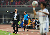 Head coach Alain Perrin of China, left, gives instructions to his players during a friendly football match against Paraguay in Changsha city, central China's Hunan province, 14 October 2014.<br /> <br /> Paraguay's dismal run of form continued as they suffered a 2-1 friendly defeat to China on Tuesday (14 October 2014). The South American nation, who came into the game having won two of their previous 13 fixtures, fell short in their bid to pull off a late comeback at Changsha's Helong Stadium. In contrast to their opponents, China have now lost just two of their last 16 matches as they continue to build towards next year's AFC Asian Cup in Australia.