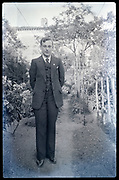 male person standing in garden portrait France 1930s