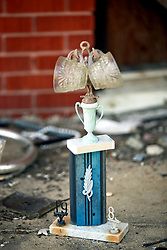 26 August 2015. New Orleans, Louisiana. <br /> Hurricane Katrina revisited. A decade later and an old sports trophy sits amidst the rubble  of an abandoned house in the Lower 9th Ward. The Lower 9 was one of the areas hardest hit by Katrina.<br /> Photo credit©; Charlie Varley/varleypix.com.