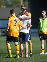 Annan Athletic's Jean Guy Lucas, and Annan Athletic's Peter Watson with Forfar Athletic's David Cox after the final whistle. Forfar Athletic 2 v 4 Annan Athletic, Scottish Football League Division Two game played 6/5/2017 at Station Park.