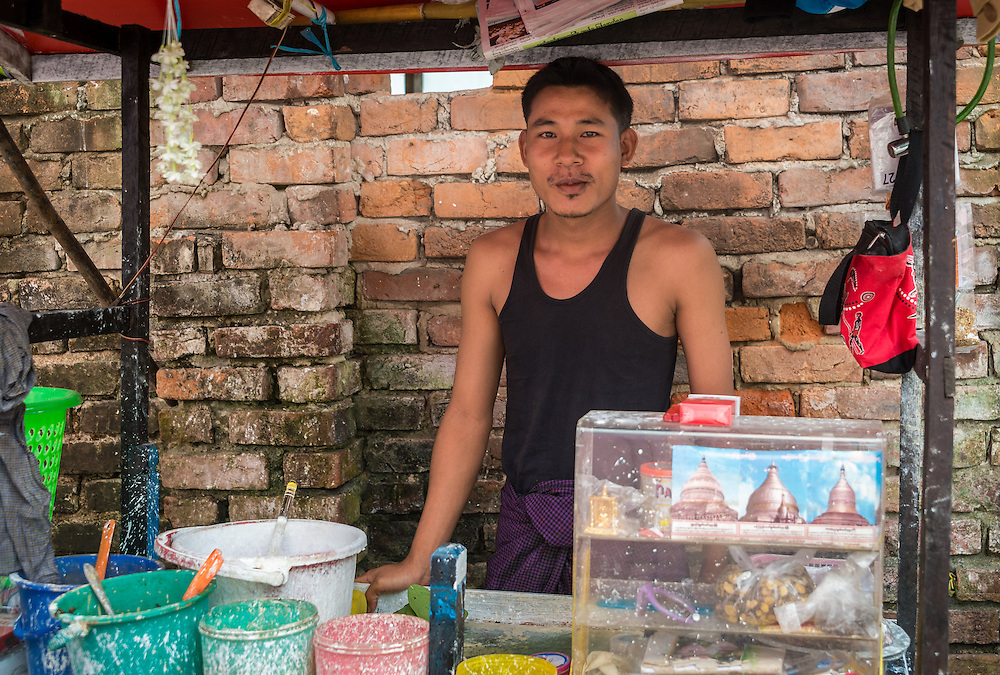 YANGON, MYANMAR - CIRCA DECEMBER 2013:  Betel nut seller in the street of Yangon