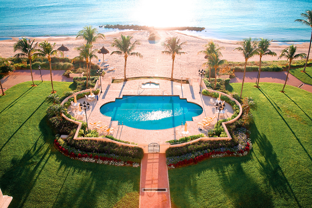 Early morning sunlight skims across a swimming pool on Florida's luxurious Fisher Island.