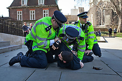 LNP Weekly Highlights 21/03/14 © Licensed to London News Pictures. 15/03/2014. London, UK. Clashes between members of the Fascist group E.V.F. anti Anti Fascists groups in Parliament Square. Photo credit : Andrea Baldo/LNP