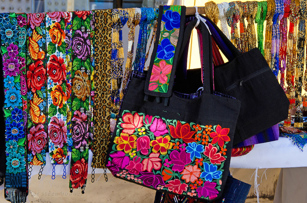 beaded belts and embroidered handbags