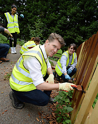 "© Licensed to London News Pictures.  London, England. 11/09/2014.   The US Ambassador to the United Kingdom, Matthew Barzun, rolls up his sleeves to help repair the Charlie Chaplin Adventure Playground in support of leading humanitarian charity ""Habitat for Humanity"". He and his staff at the American Embassy have again heeded President Obama's call to all Americans to remember the tragic events of 9/11 by giving a day of service to the community they live and work in. Photo credit : Mike King/LNP"