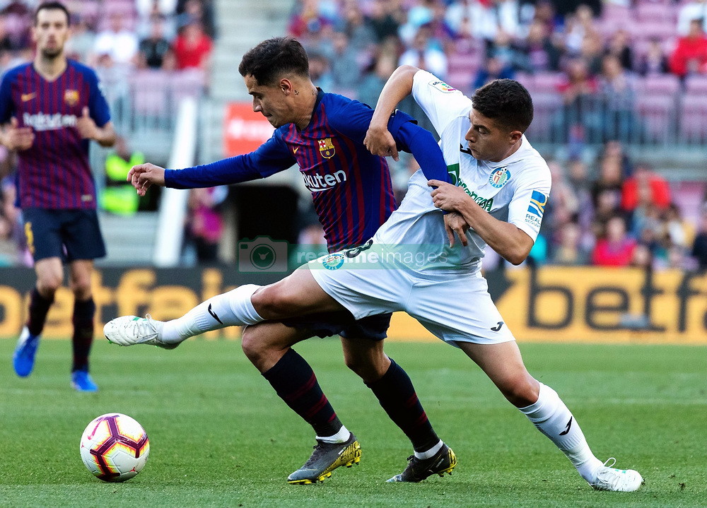 BARCELONA, May 13, 2019  Barcelona's Philippe Coutinho (L) vies with Getafe's Francisco Portillo during a Spanish league match between FC Barcelona and Getafe in Barcelona, Spain, on May 12, 2019. FC Barcelona won 2-0. (Credit Image: © Joan Gosa/Xinhua via ZUMA Wire)