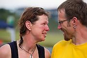 Petra von Fintel wordt gefeliciteerd door haar partner na het uitrijden van de 24-uursrace. In Duitsland worden op de Dekrabaan bij Schipkau recordpogingen gedaan met speciale ligfietsen tijdens een speciaal recordweekend.<br /> <br /> Petra von Fintel is congratulated by her partner after she finishes the 24-hours race. In Germany at the Dekra track near Schipkau cyclists try to set new speed records with special recumbents bikes at a special record weekend.