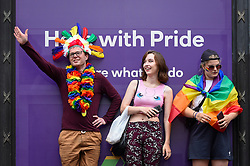 © Licensed to London News Pictures. 06/07/2019. LONDON, UK.  People watch the parade from a high vantage point. Tens of thousands of visitors, many wearing eye-catching costumes, gather to watch and take part in the annual Pride in London Parade, the largest celebration of the LGBT+ community in the UK.  This year's event also celebrates 50 years since the birth of the modern LGBT+ rights movement. Photo credit: Stephen Chung/LNP