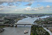 Nederland, Zuid-Holland, Gemeente Rotterdam, 23-10-2013; Van Brienenoordbrug met autosnelweg A16 over de Nieuwe Maas. De rivier vervolgt naar rechts, naar links splitst de Hollandsche IJssel zich af (met de stormvloedkering in Capelle aan den IJssel).  Links kantoren aan het water in Kralingse Veer (deelgemeente Prins Alexander), rechts flats en eengezinswoningen in Oud-IJsselmonde en Beverwaard. Air view on the river Meuse at Rotterdam, with the double bridge (Van Brienenoord) of the motorway A16, connecting the north and the south bank of the river. The river branches off into two rivers .<br /> luchtfoto (toeslag op standard tarieven);<br /> aerial photo (additional fee required);<br /> copyright foto/photo Siebe Swart
