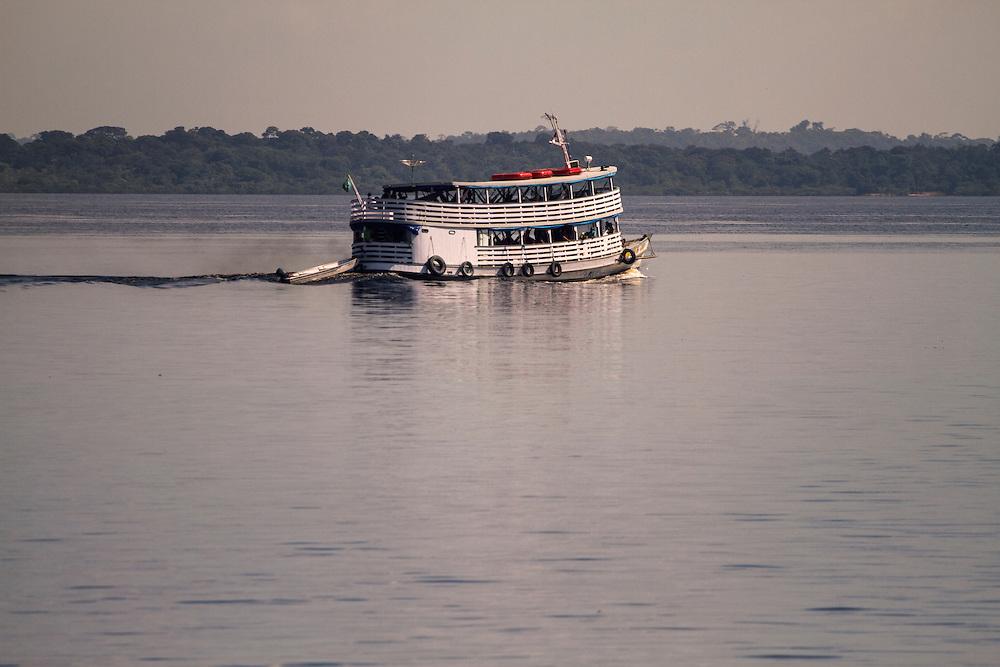 Boat sailing down the Rio Negro river, in the Amazon, Brazil.