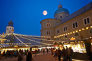 People at a snowy Christmas market in Salzburg Austria