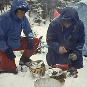 Lighting a stove on a camping trip in mid-winter in the White Mountain National Forest.