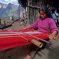 A young woman weaves outside her family's homestead in Peru's Cordillera Vilcabamba.