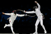 Mcc0041438 . Daily Telegraph..DT Sport..2012 Olympics..Learn to Love..Venezuelan Ruben Limbardo wins Gold in the mens Epee Finals after defeating  Norway's Bartosz Piasecki at the ExCel centre...1 August 2012...